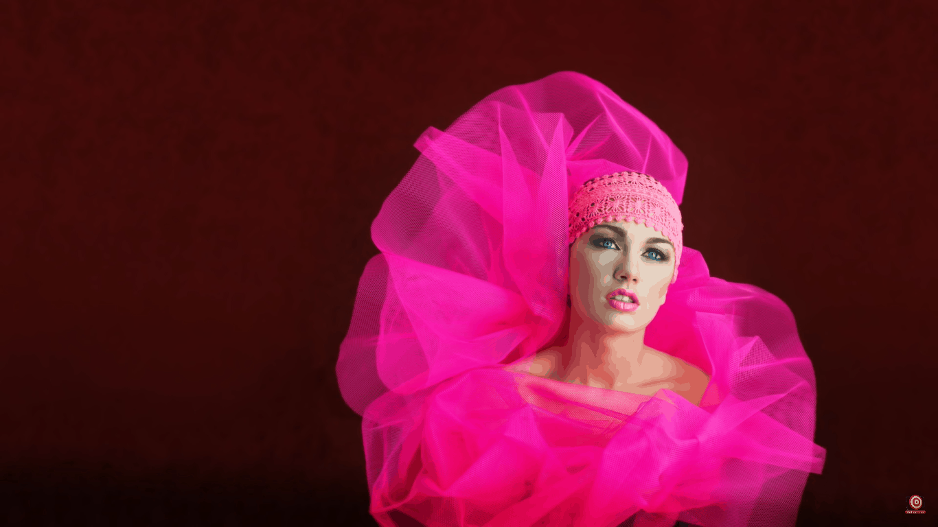 Model in front of velour backdrop wrapped in pink tule