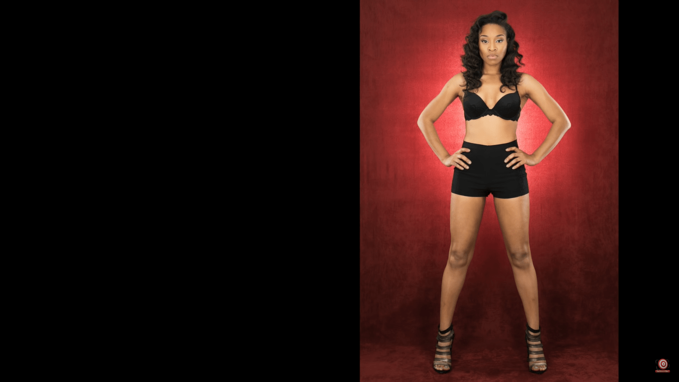 model in front of velour backdrop lit from behind full legth shot