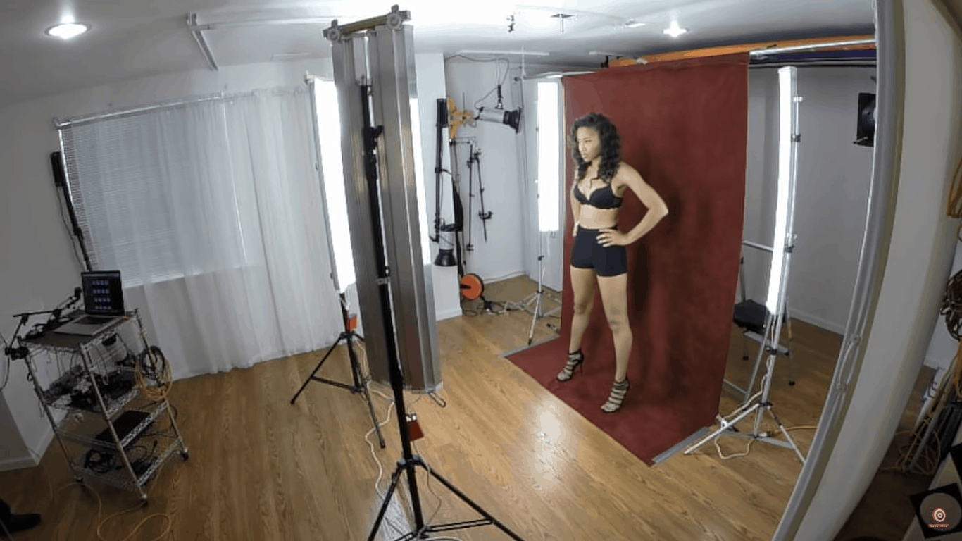 Model positioned close to velour backdrop