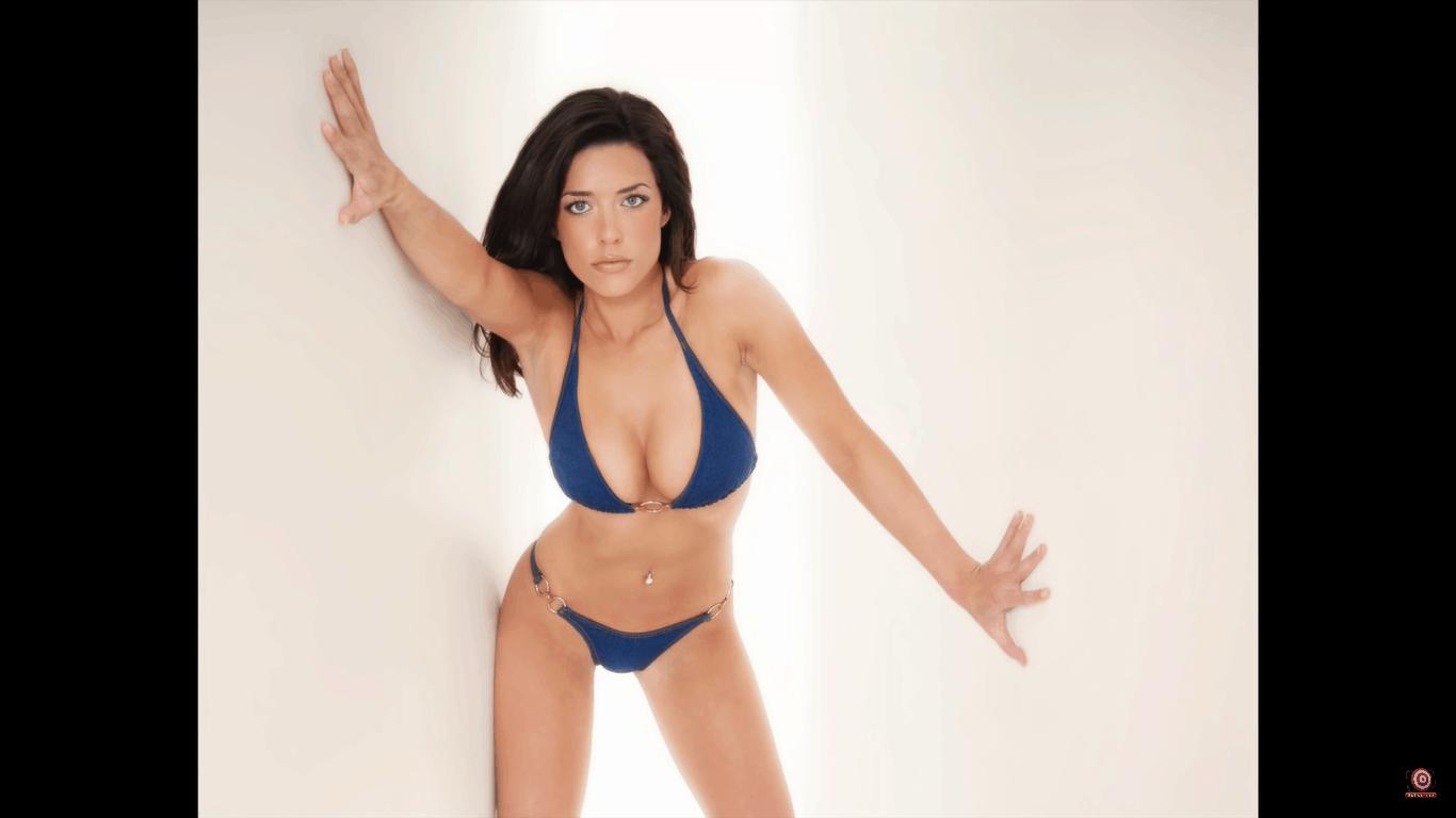 model in blue bikini posing in same glamour lighting setup