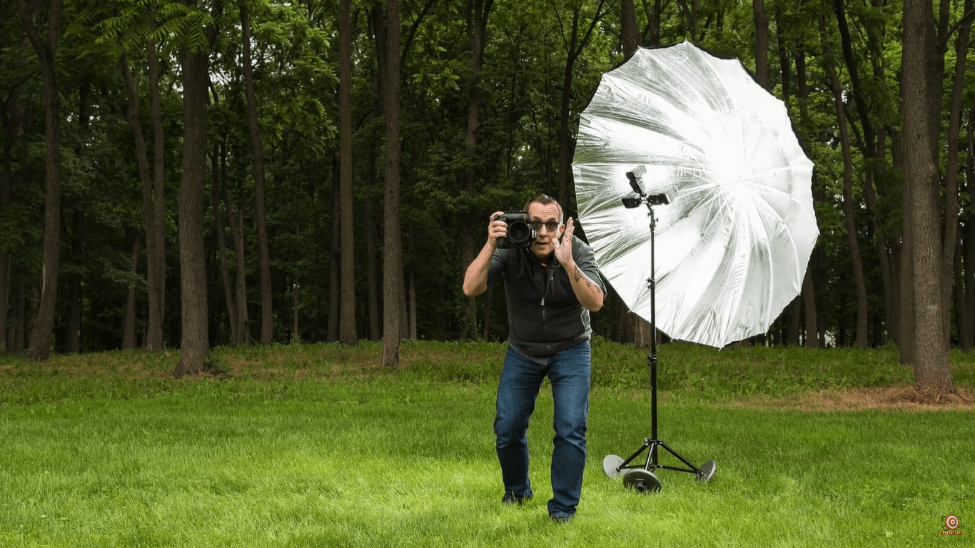 Joe making a funny face with lightstand supported by StandDaddy in background